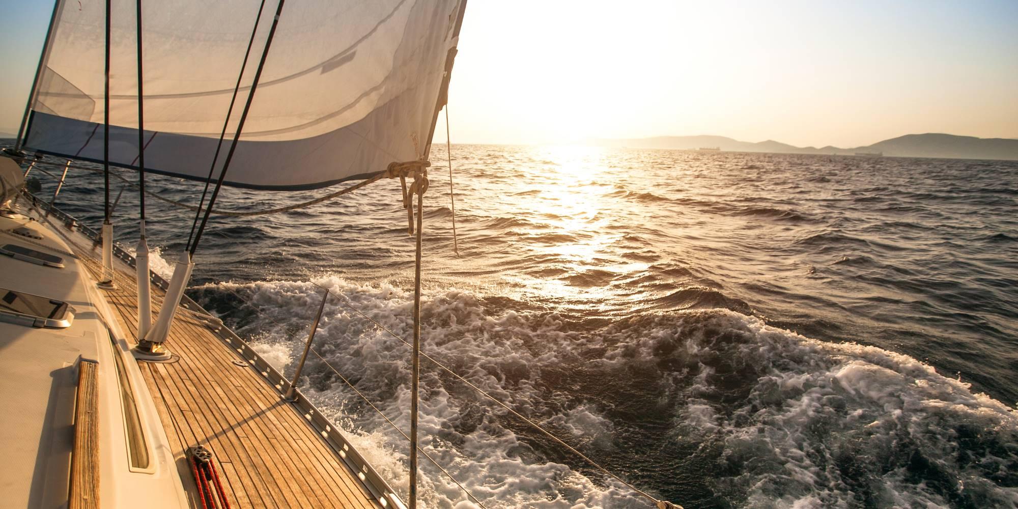 yacht-sailing-towards-the-sunset-35216548